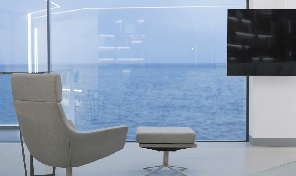 A TV lounge chair also overlooks the water