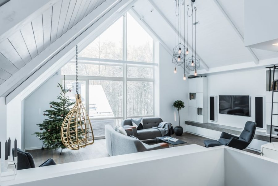 A hanging chair is a great addition to an open layout living room 900x601 House on Stilts in Lithuanian Forest Has the Most Stylish Interiors
