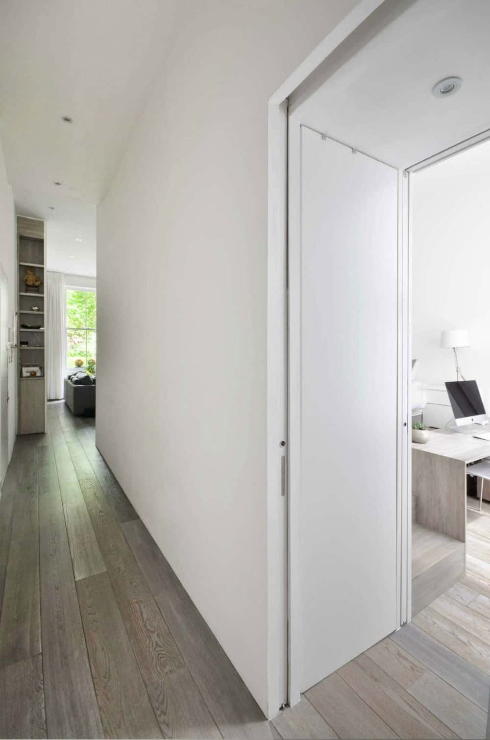 A narrow corridor leads from the living area to the bedroom