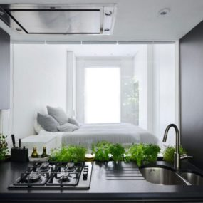 Small London Apartment With an Interior Window That Makes a Huge Difference
