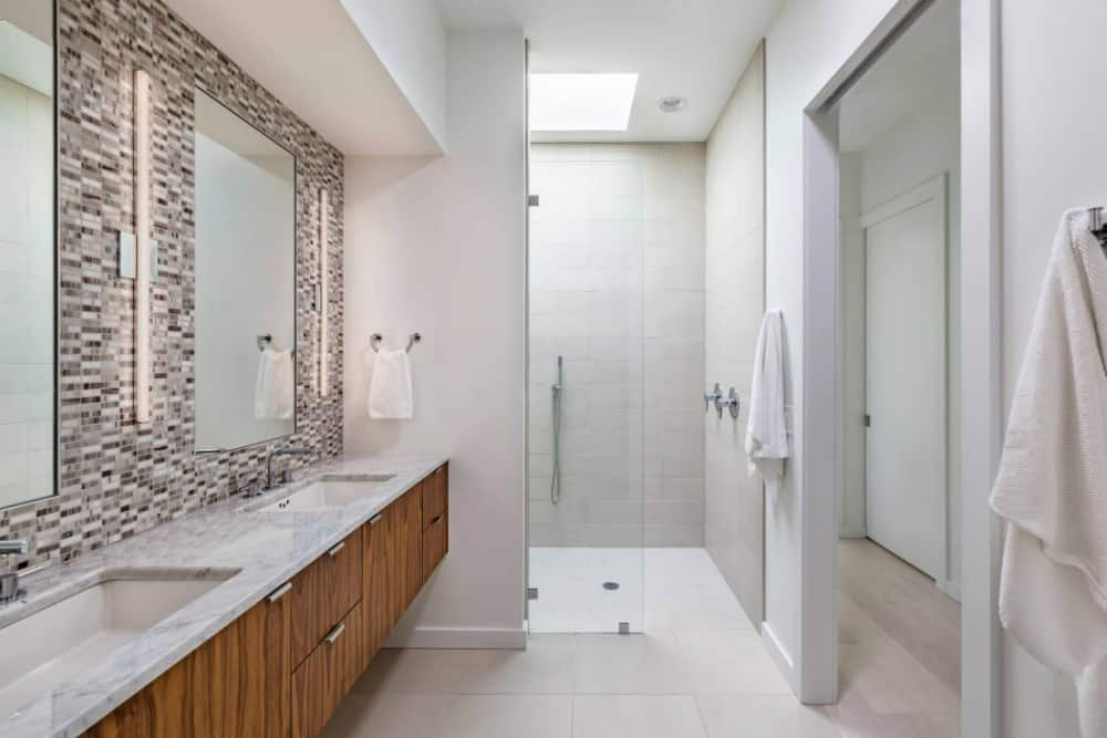 Bathroom is spacious and white