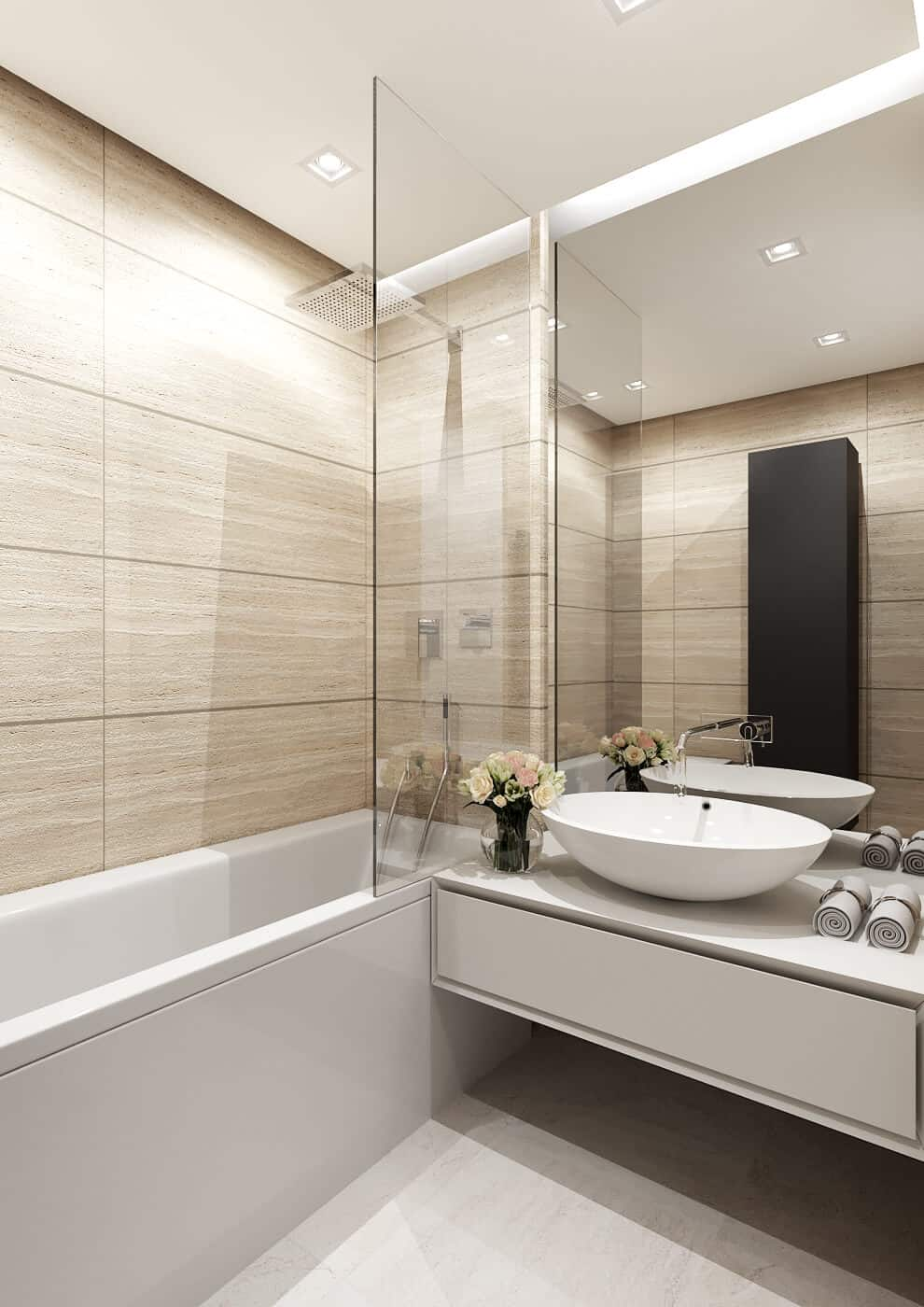 Bathroom takes advantage of light wood-look tiles to create an elegant but homey look