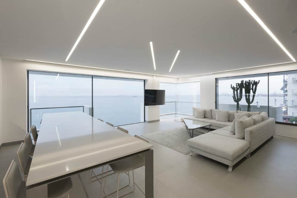Big glass inclusions create a floating effect at least from one side of the living room