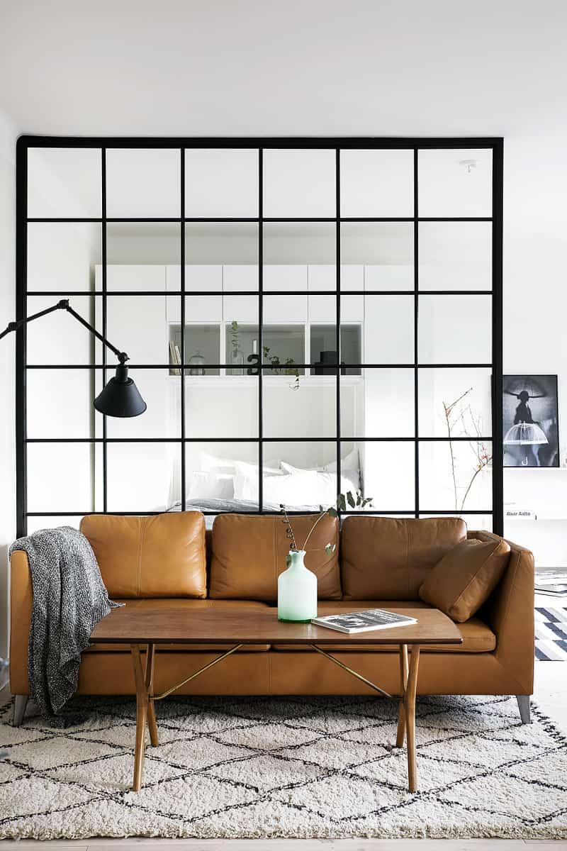 Black-framed sleeping area divider