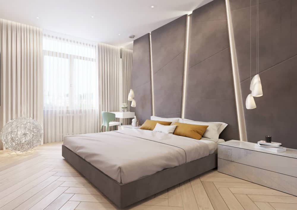 Contemporary bedroom continues the elegant theme with taupe bed and a matching soft wall