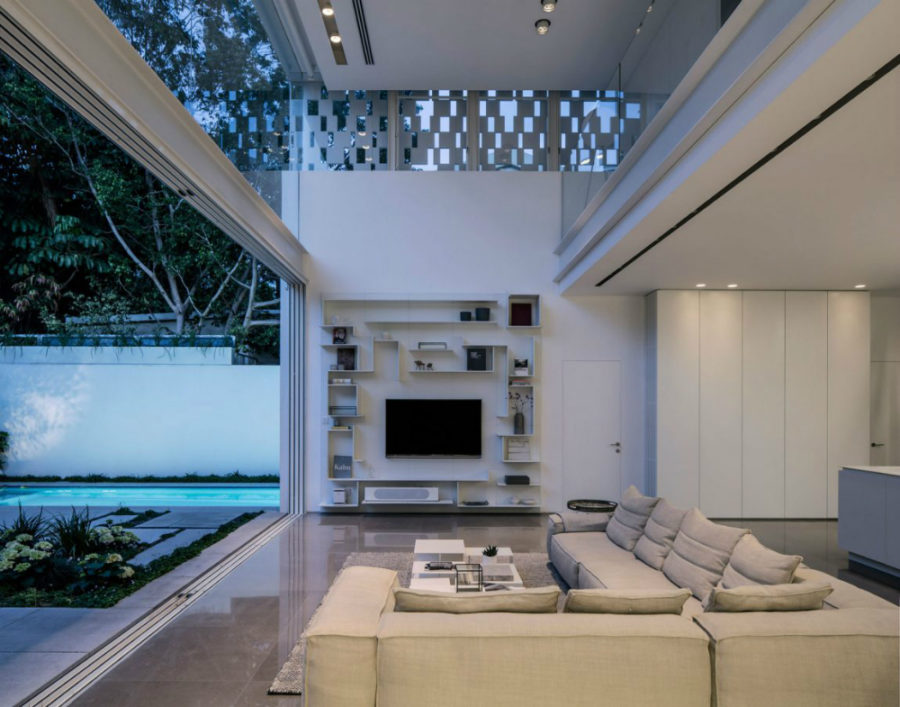 Contemporary residence by Pitsou Kedem Architects 900x707 Living Room Storage Ideas That Will Make Clutter Dissolve