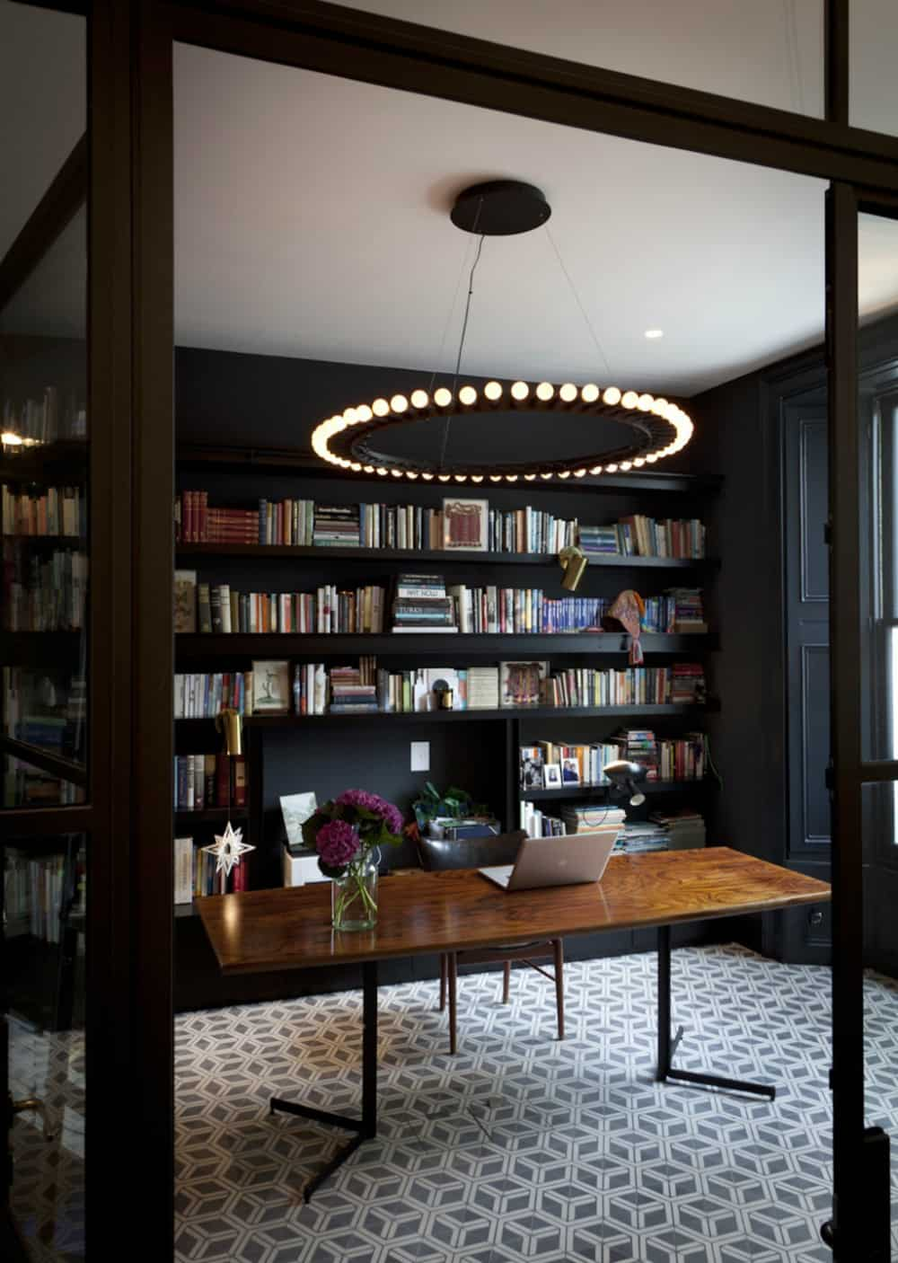 Cool stylish home office with a library