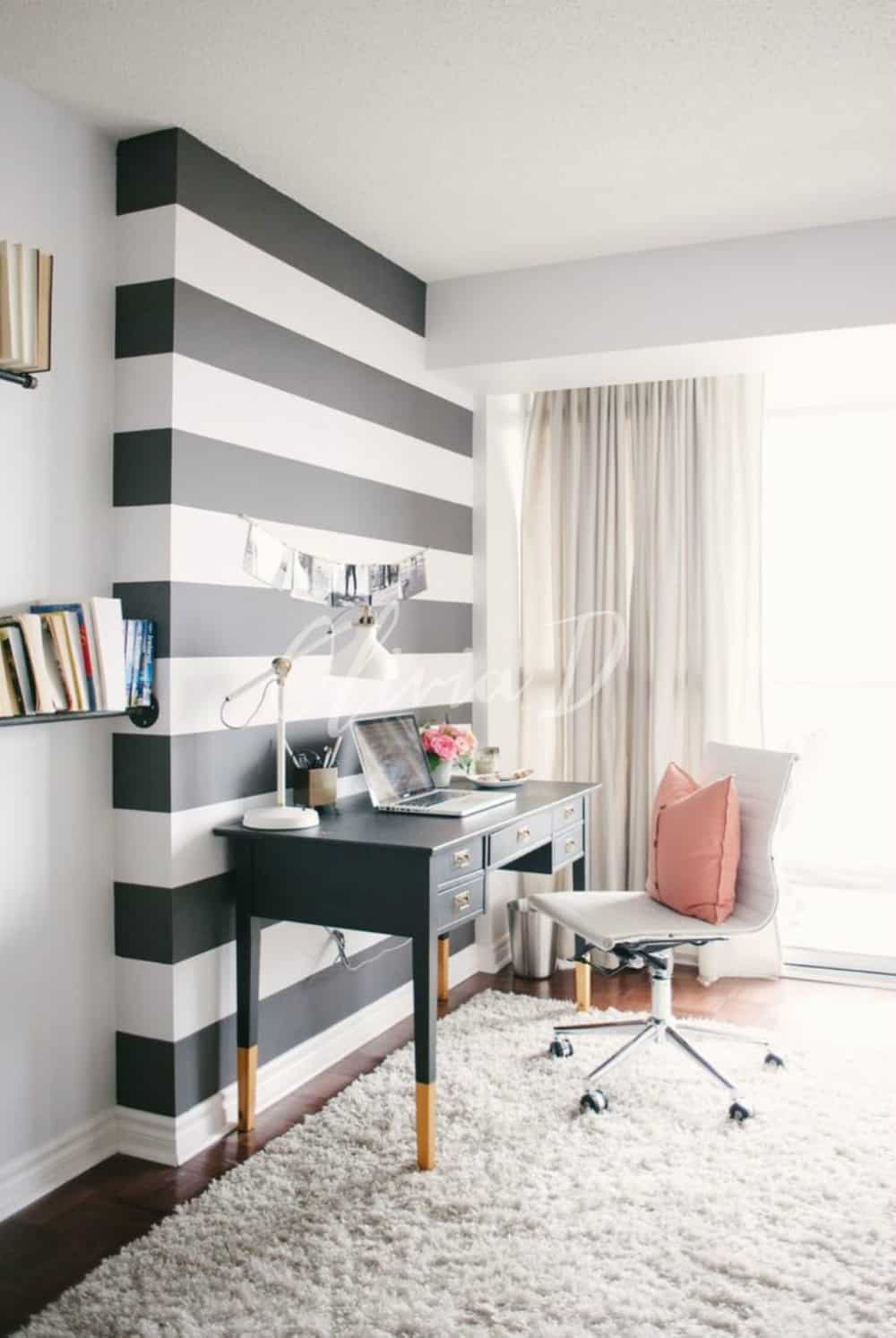 Fashionable home office with a striped feature wall