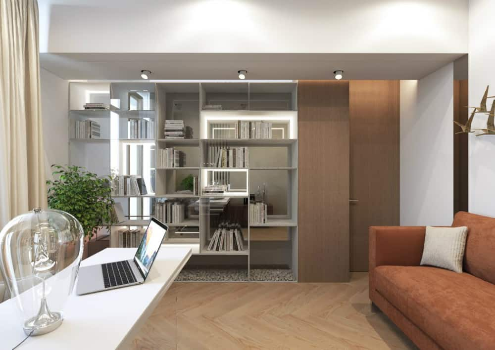 Home office stands behind an open shelving protected by glass