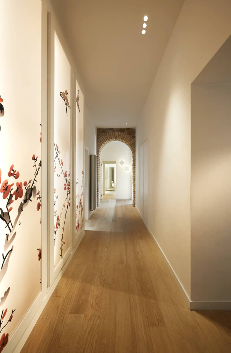 Long corridor enjoys the floral wall decor