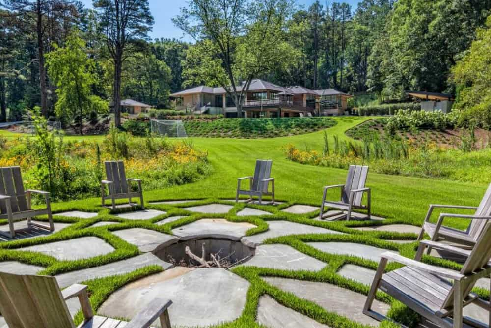 Manicured lawn end with a hardscaped fire pit lounge area
