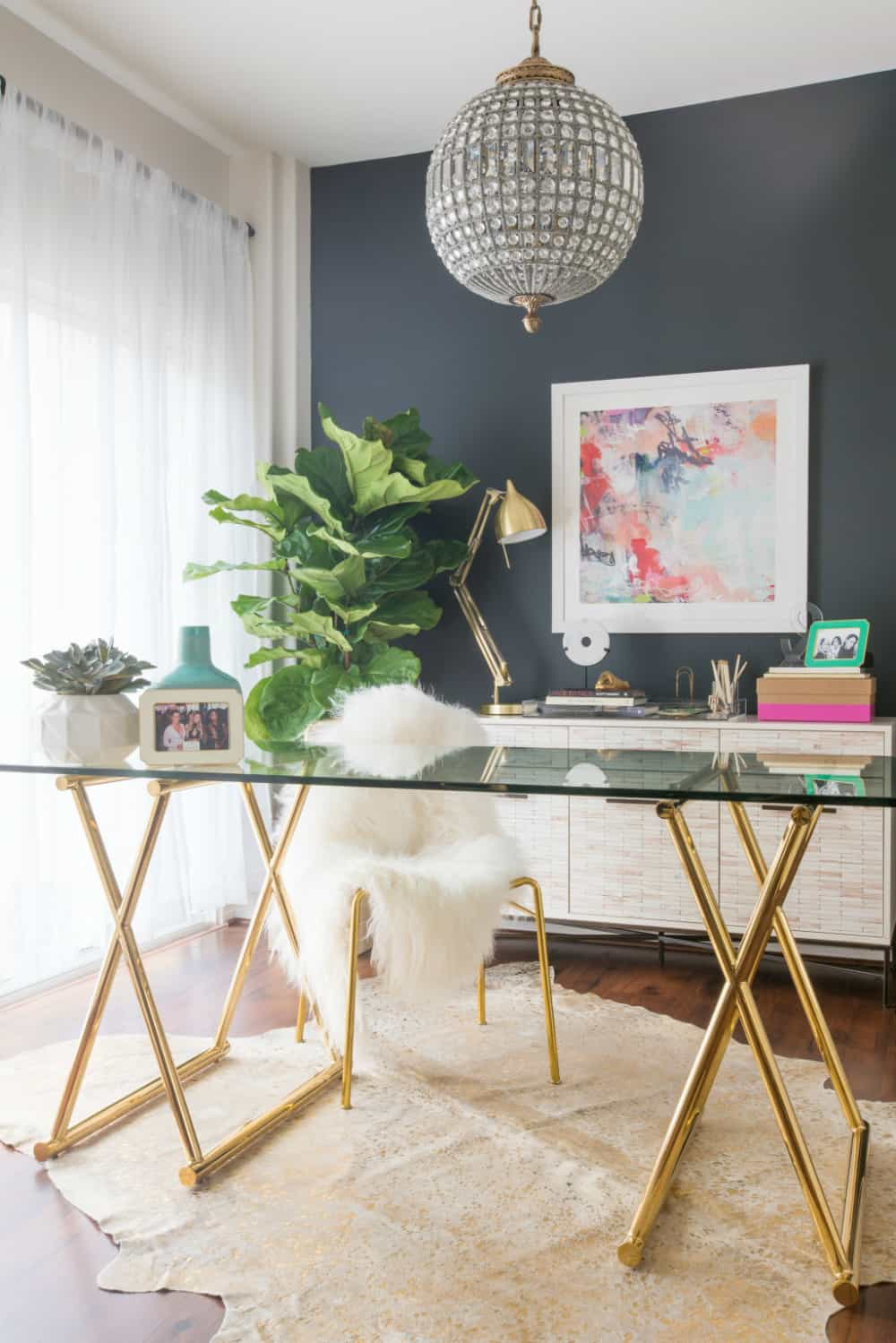 Metallic desk with a dark feature wall