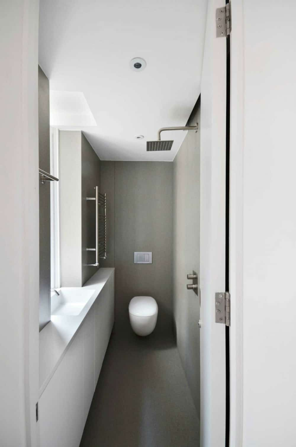 Narrow shower and toilet are simply functional