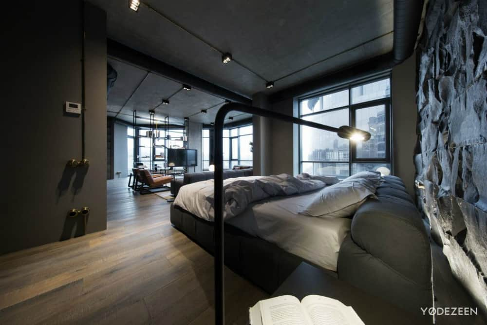Open plan bedroom overlooks the contemporary living room