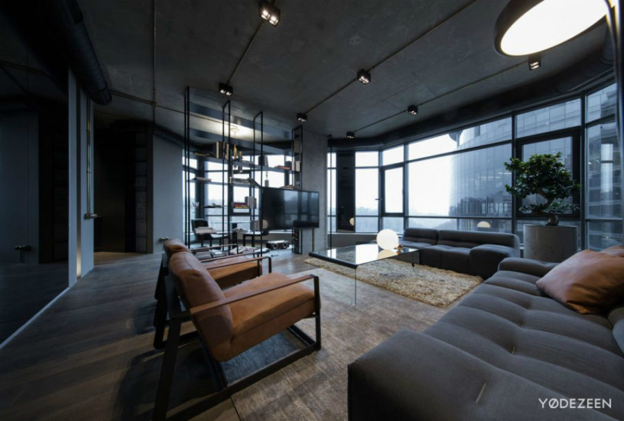 Panoramic windows allow to see beyond the neighboring glass skyscraper 900x607 Dark Apartment in Kiev Maximizes Space With Reflective Surfaces