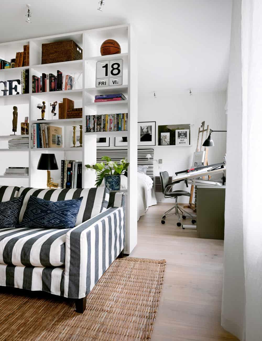 Shelving-divided bedroom