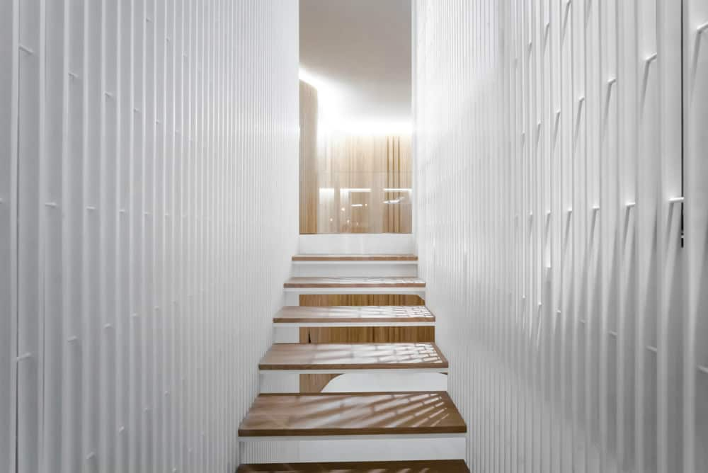 Staircase structure is filled with light thanks to its design