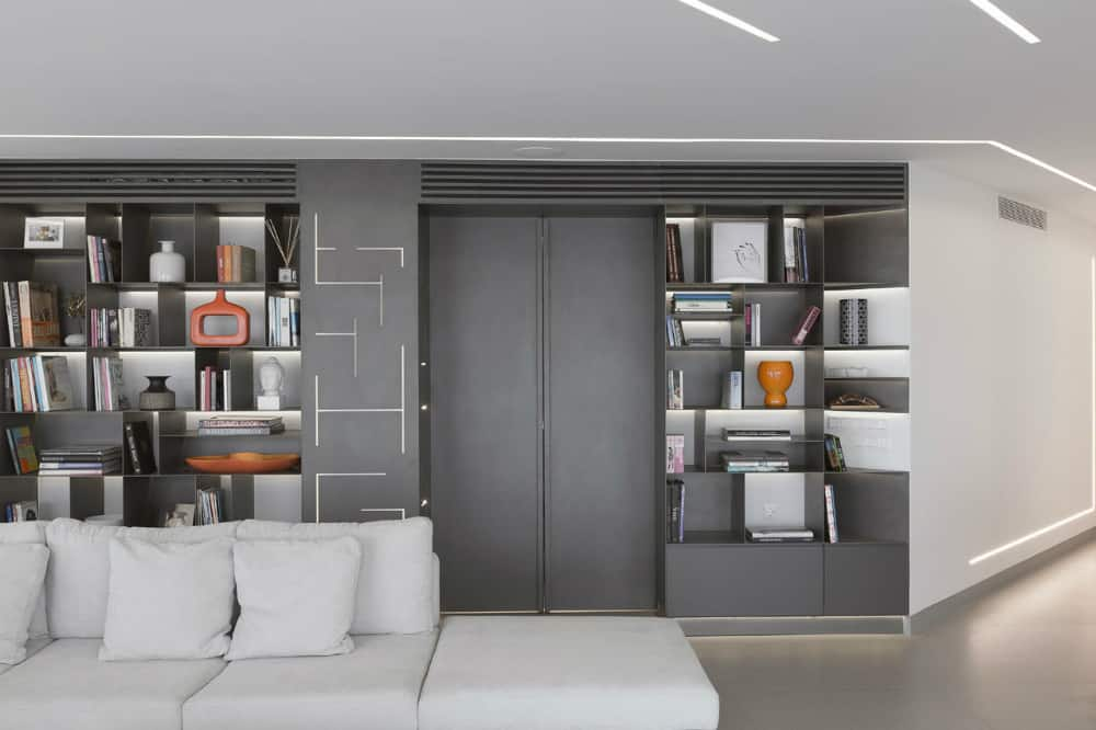 Storage wall behind the living area hides a bedroom