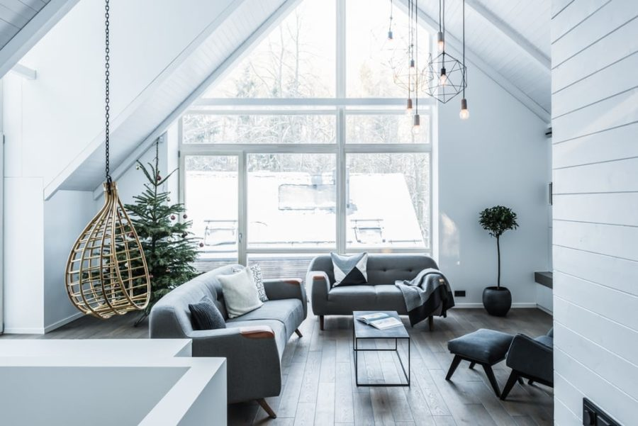 Windows fill the living room wall almost completely 900x601 House on Stilts in Lithuanian Forest Has the Most Stylish Interiors