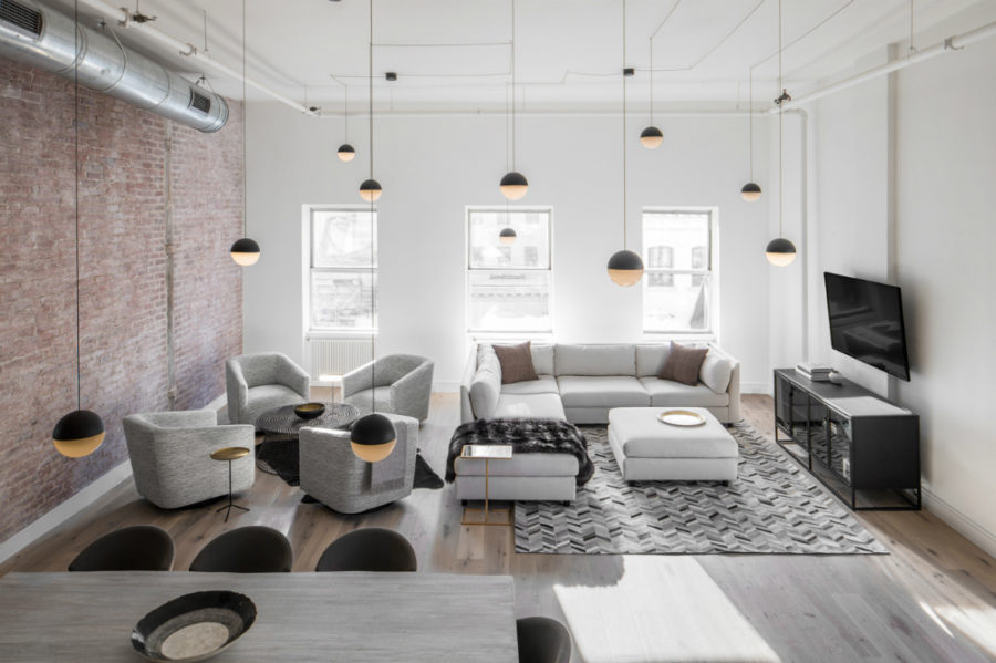 With the number of pendants youd think it were a home style cafe 900x599 Decor Aid ed: TriBeCa Loft Filled With Neutrals