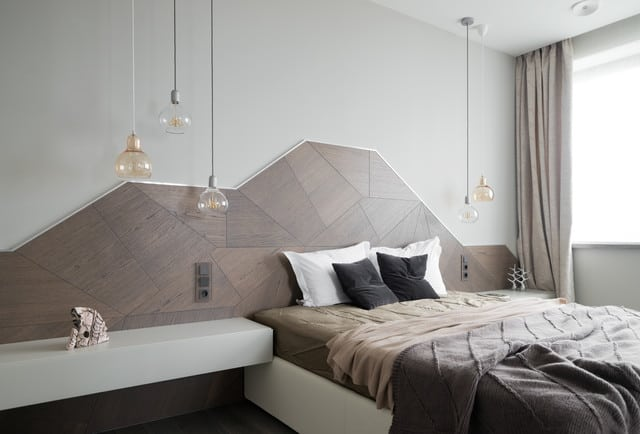 Eccentric and modern home bedroom with a geometric headboard