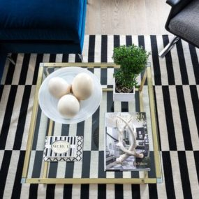 Add a striped black and white rug under coffee table 285x285 5 Ways to Style a Coffee Table