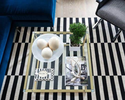 Add a striped black and white rug under coffee table