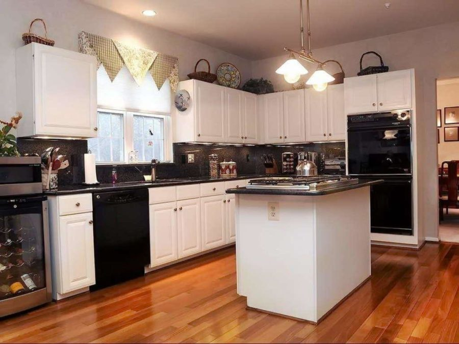 white kitchen cabinets and black appliances our on the best kitchen design trends 28661