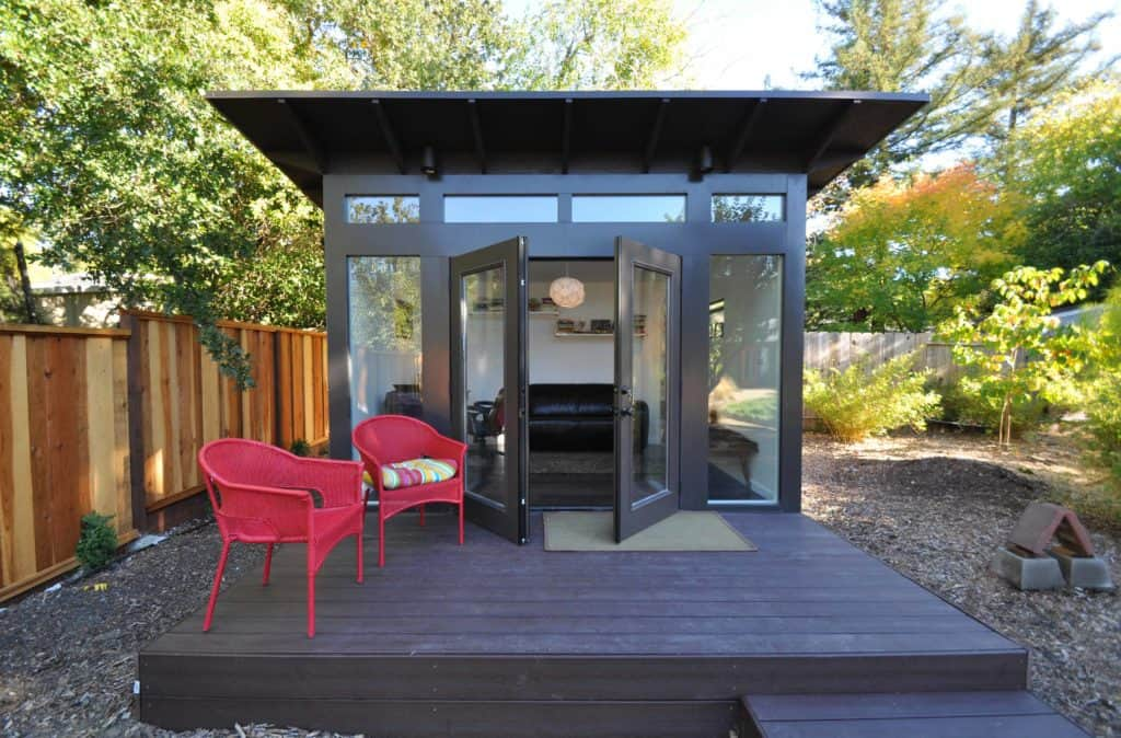 Black modern backyard shed turned into a guest house