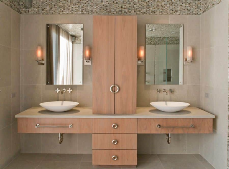 Incorporate natural materials with this double sink on cabinets made of wood.