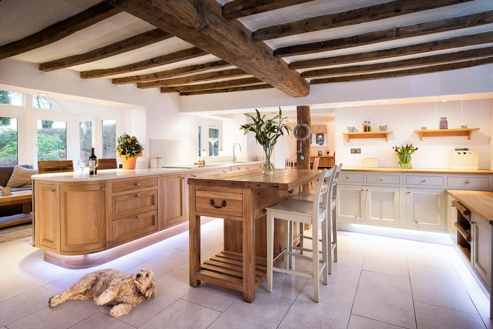 Large and open kitchen deign with wood ceiling beams
