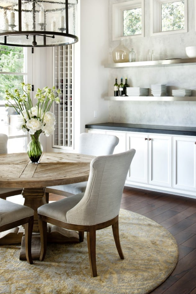 Round dining table for a farm style kitchen – verical wine storage