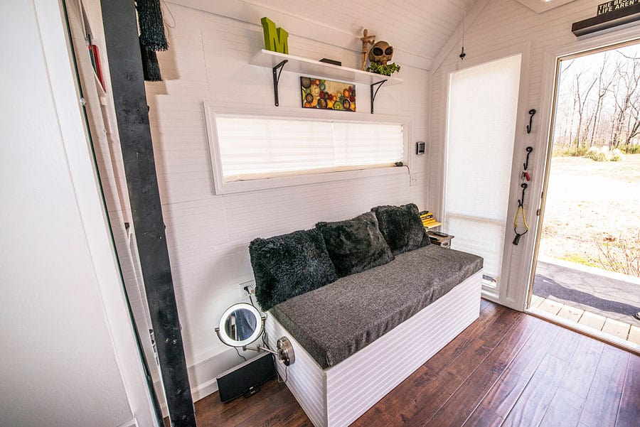 Use bench seating as storage in a smaller she shed.