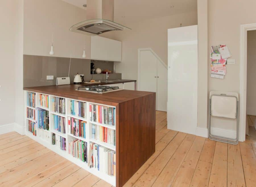 Maximize space with a kitchen island that has shelving.