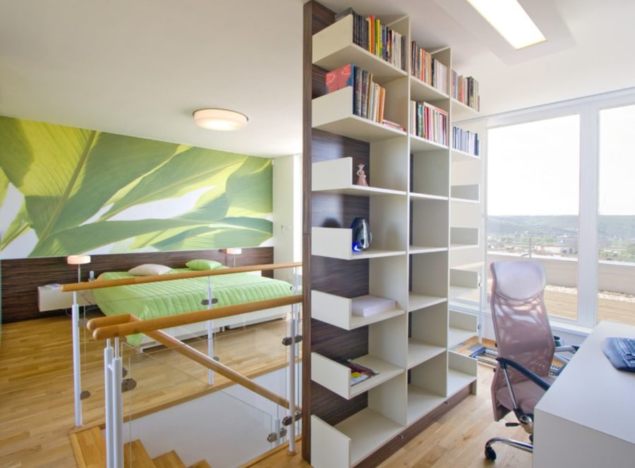 Separate a space with a bookshelf room 900x664 23 Built In Bookshelves to Strike Your Fancy