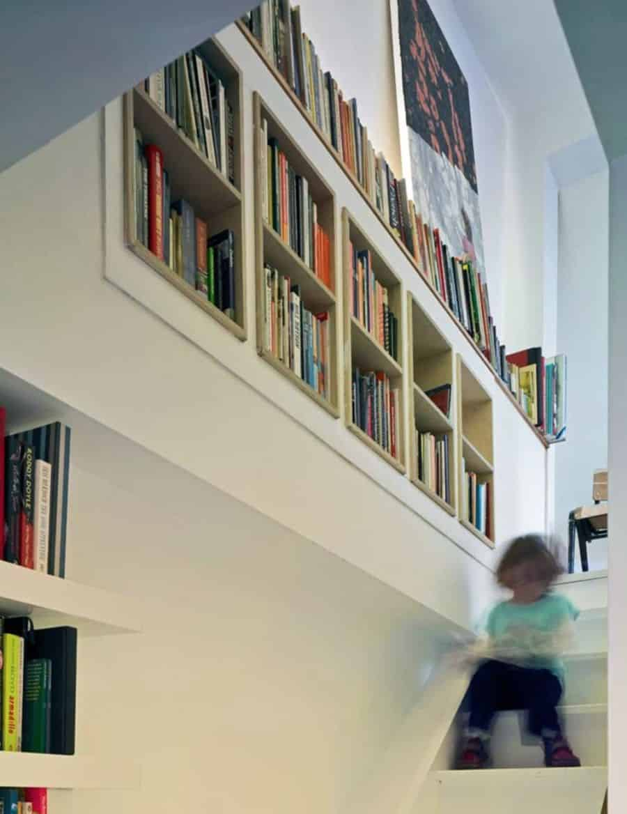 Use often ignored space with recessed shelving.