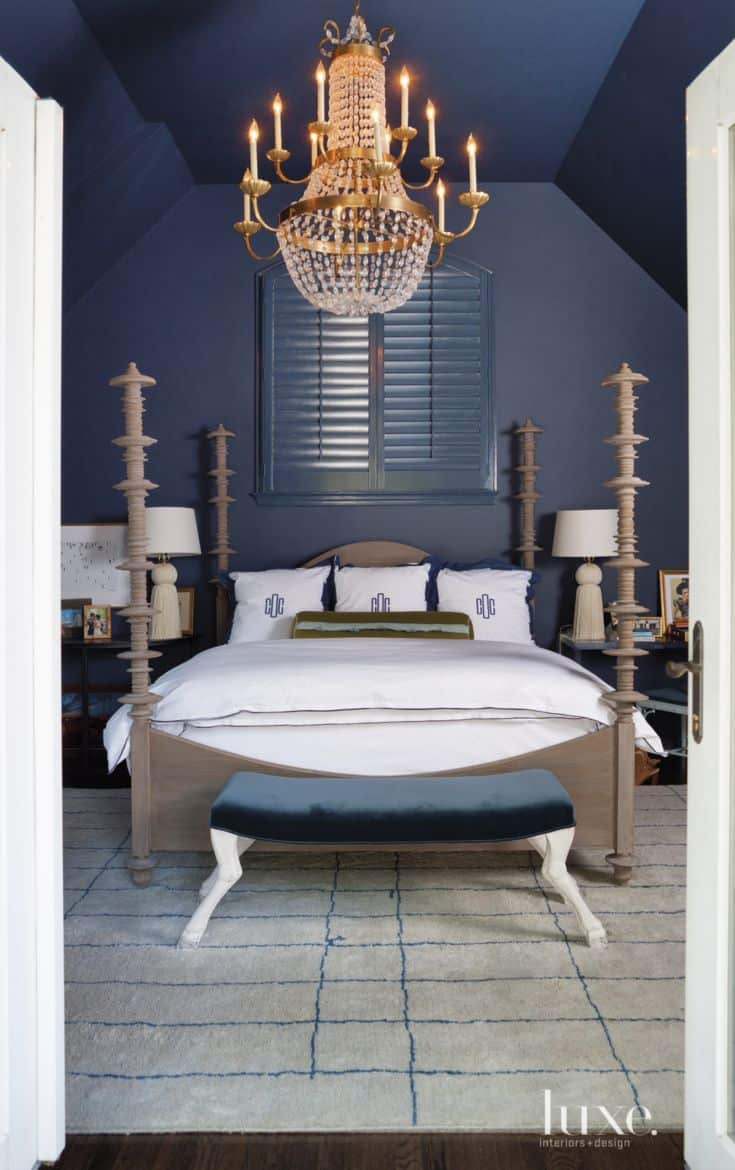 brass chandelier in blue bedroom