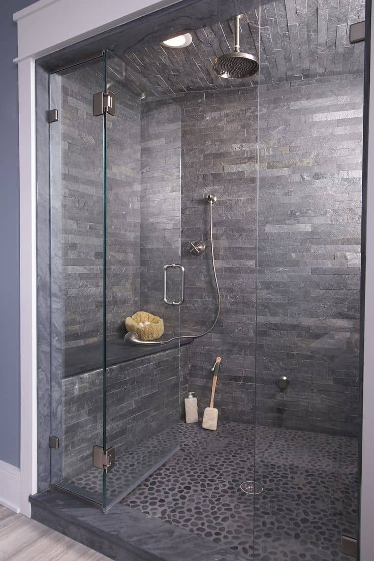 dark stone shower cave 15 Tile Showers To Fashion Your Revamp After