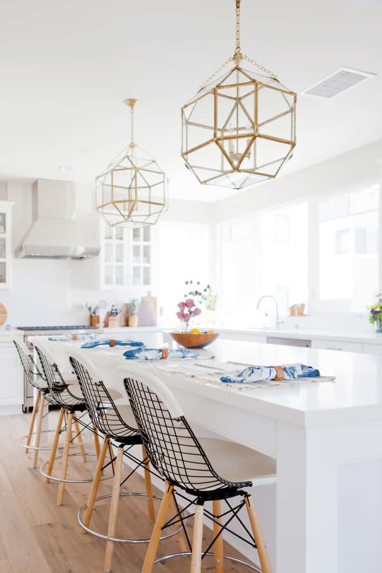 dining area in white with pendant light Simple yet Lovely Ideas for a White Room