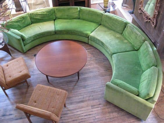 green curved sectionla sofa