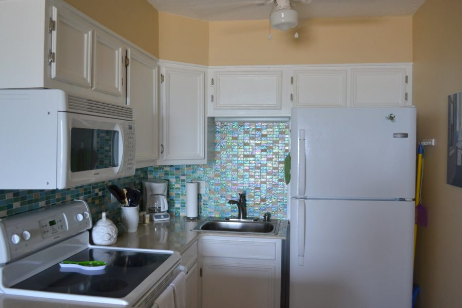 kitchen interior decoration ideas comely home interior design using beach glass backsplash tile wall kitchen decoration ideas with white wooden wall mounted cabinet also blue glass beach backsplash t 900x600 15 Glass Backsplash Ideas To Spark Your Renovation Ideas