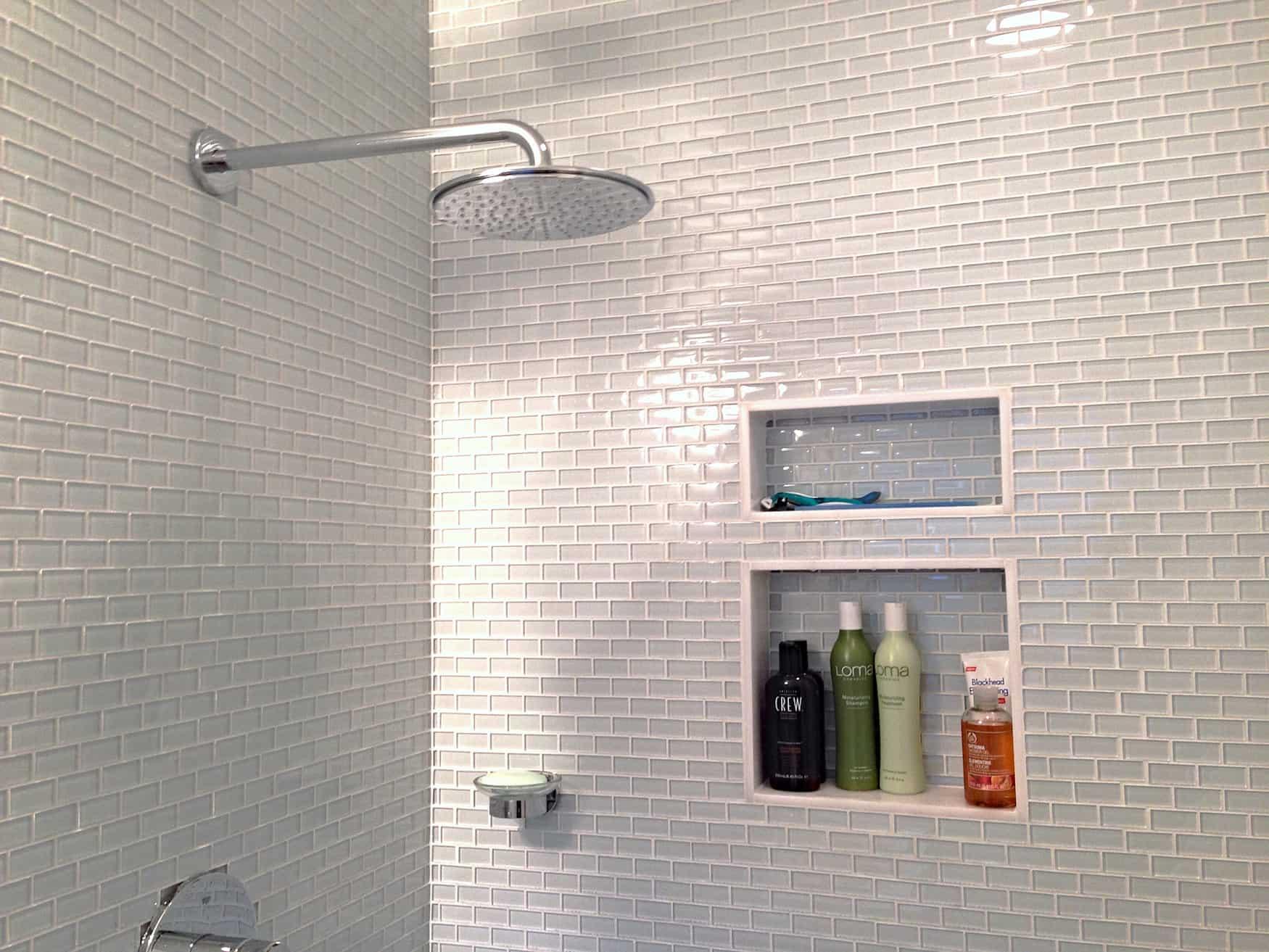 white glass mini subway tile shower walls