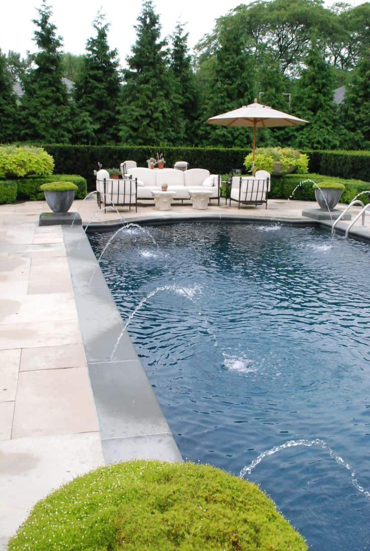 Elongated rectangule pool design with water fountains