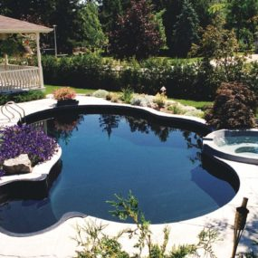 Pair your dark blue pool with rich tones around it for an even grander vacation effect in your backyard space