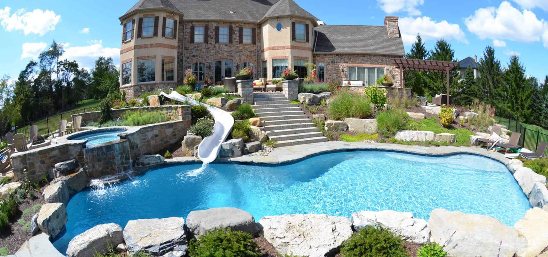 large natural rock pool design water jacuzzi and water slide