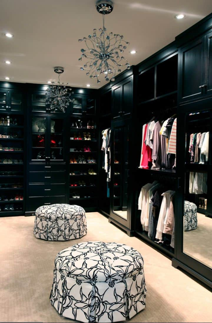 An all black closet is an edgy yet classic twist on the traditional walk-in closet