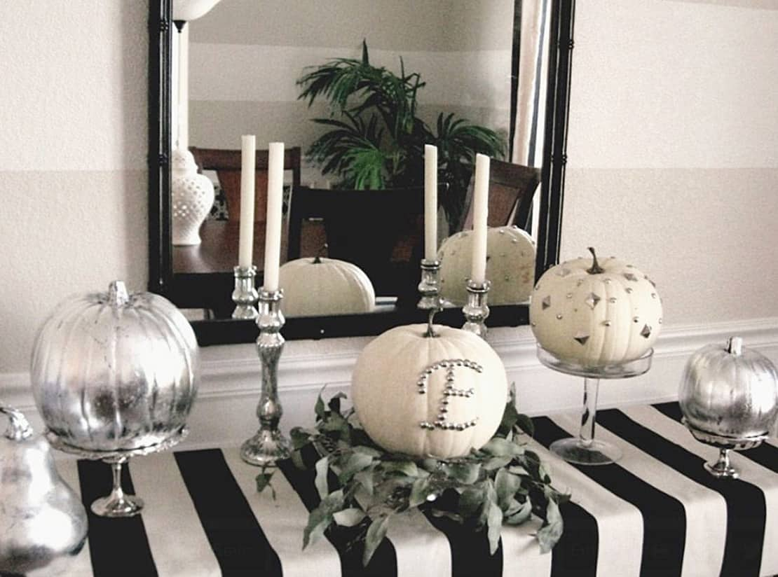Although we love the idea of black and having black candle holders for an edgy look.