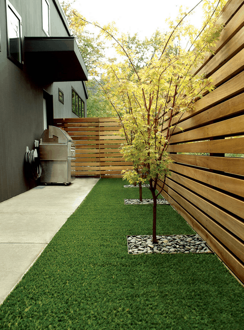 Combine your faux grass with fresh elements to give it the natural feel you want.