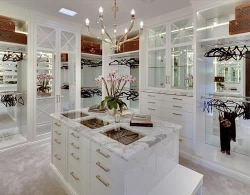 The excellent aspect of having an island inside of your walk-in closet is that it can become an extra storage space.