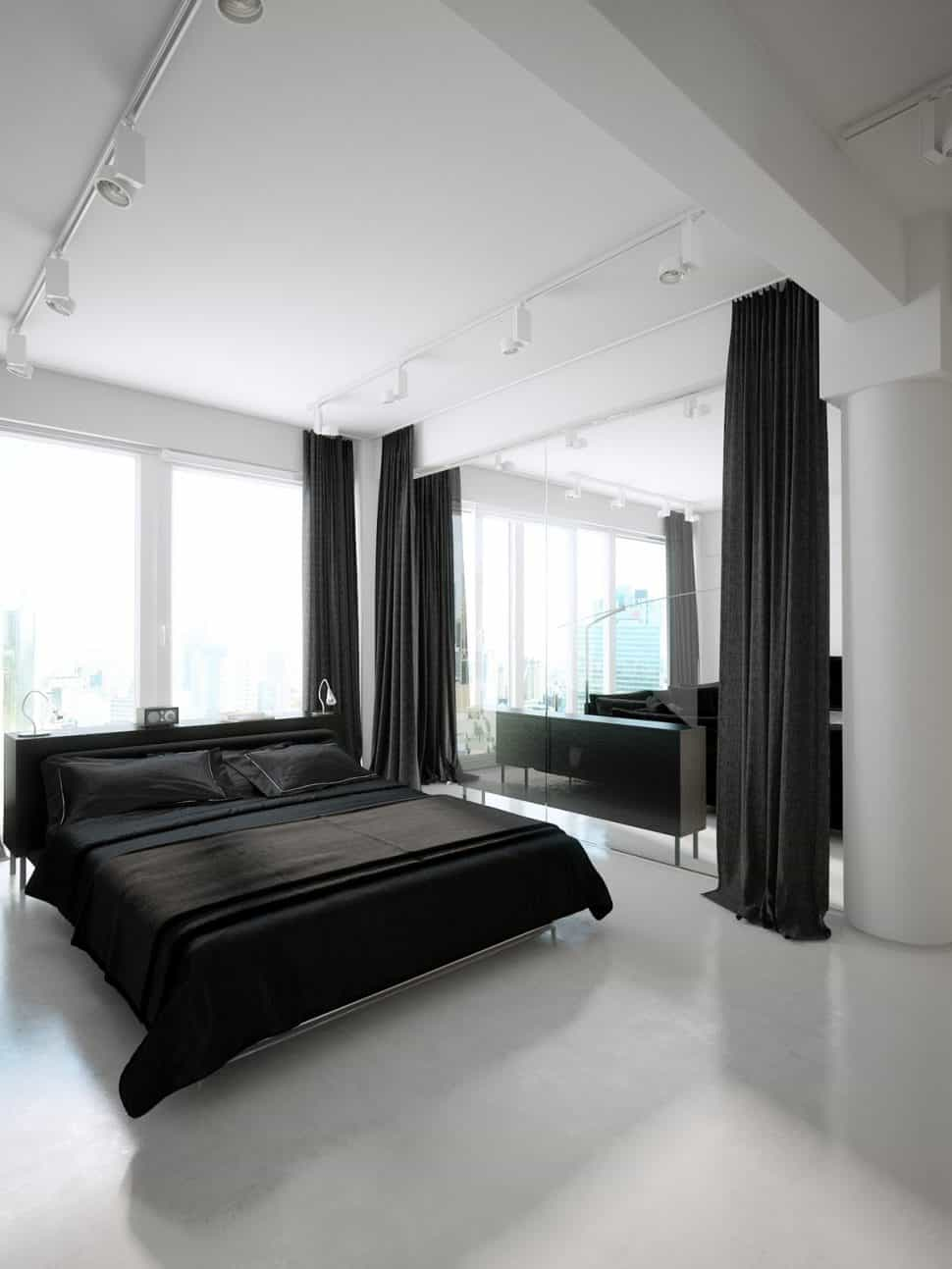 minimal bedroom with black bed and curtains